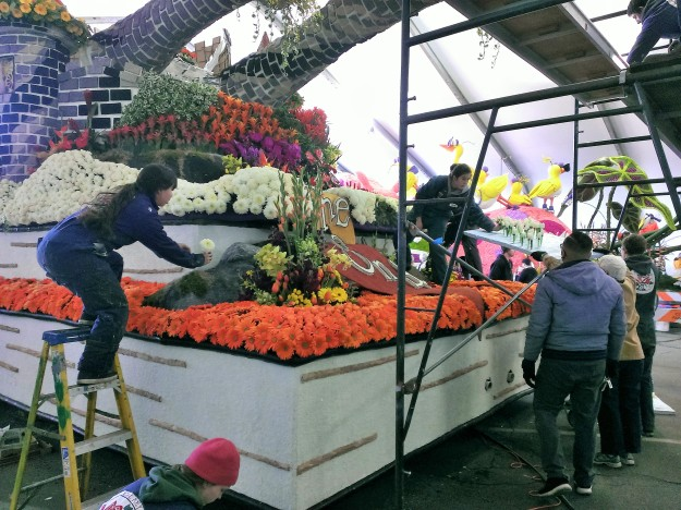 Volunteers were hard at work getting the float completed before the deadline.