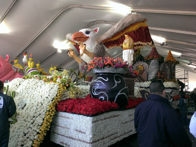 A view of the construction from the front. Besides fresh flowers, dried flower petals are often glued onto floats to give added color. Orange or other citrus peels were also common on many floats. For an example, check out the gryphon's beak.