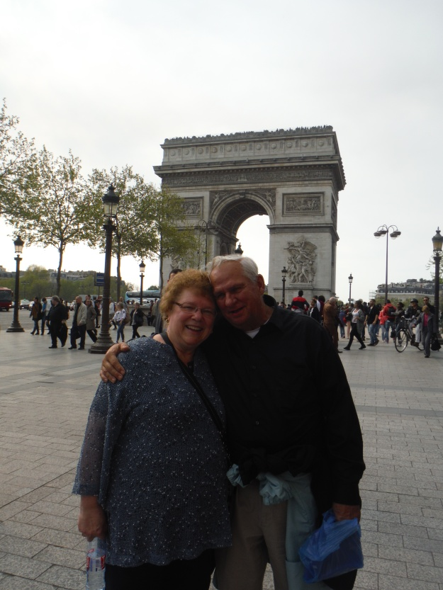 We also went to the Arc de Triomphe. We climbed and climbed and climbed the spiral staircase to the top. I love watching all the cars go 'round. Don't my parents look cute in front of it?