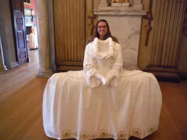 In addition to the furniture, some of the rooms had period clothing made out of paper. Can you imagine having to fit through a door or sit in this dress?