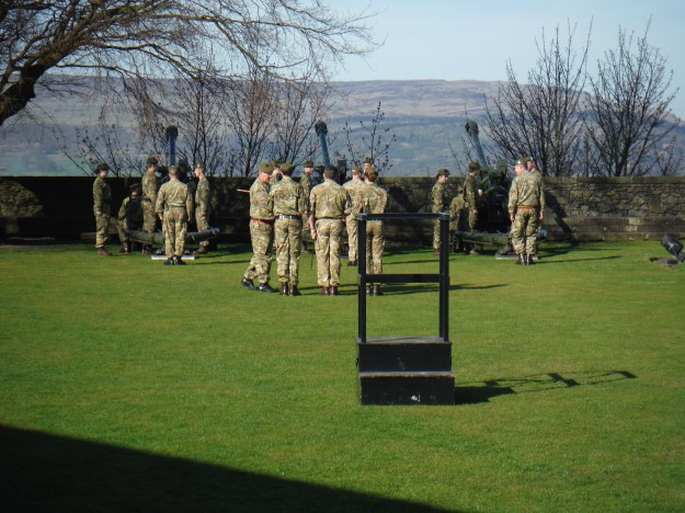 On the castle lawn, they were preparing a 21-gun salute for Queen Elizabeth II's birthday.