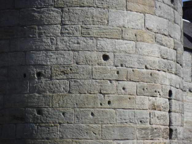 "The castle has seen numerous battles including an unsuccessful takeover attempt by ""Bonny Prince Charlie."" This is damage from cannonballs."