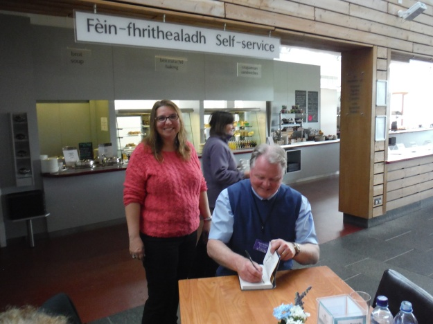 "Lightening the mood, our guide, Hugh Allison, is autographing his book ""Culloden Tales"" Stories from Scotland's Most Famous Battlefield"" for me. It was great having someone who knew the history so well take us around not only the battlefield, but all over the Highlands."