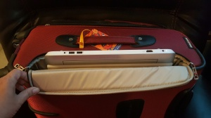 My HP 2-in-1 easily fits inside the laptop pocket.