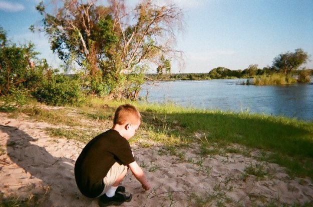 No field trip to the zoo needed here. My son is playing on the shore of the Zambezi River in Africa during a wildlife cruise.