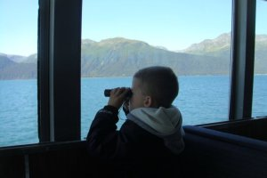 My son watching for whales and other wildlife in Alaska.