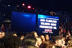 The huge teleprompters mid-audience.